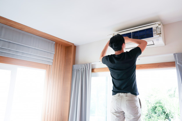 technician-man-repairing-cleaning-maintenance-air-conditioner_101276-5